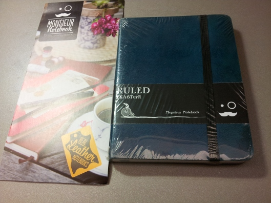 brochure and wrapped notebook
