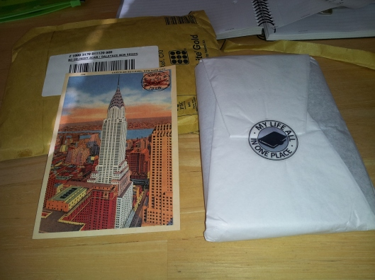 1 postcard and wrapped notebook