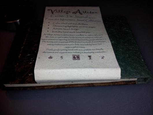1village artisan center tie journal