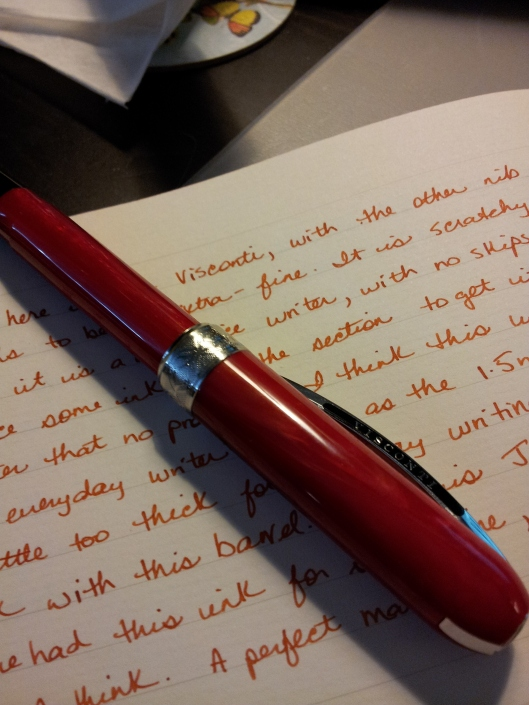pen laying on orange writing