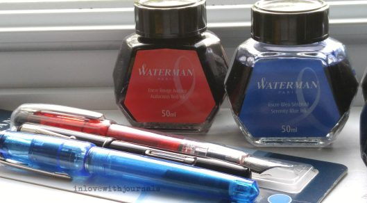 blue and red and pens